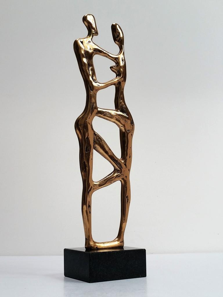 Viņš un viņa, 1992. Bronza, granīts. 50x15x10 cm. Privātkolekcija, ASV